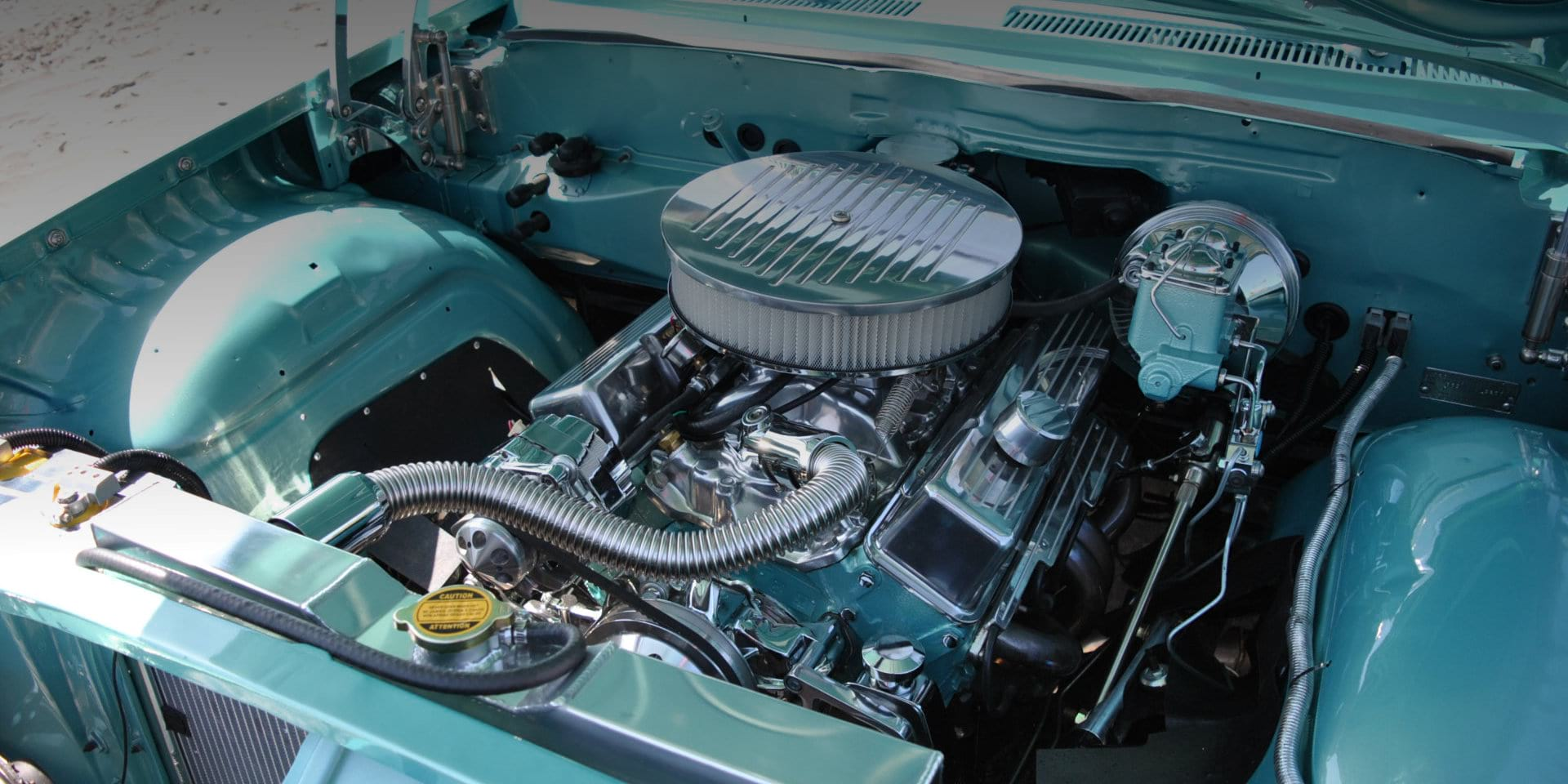 blue car with opened hood